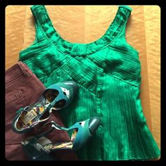 DVF Green Silk Pleated Top Emerald green sleeveless top from Diane von Furstenberg!  This top features a myriad of pleats with an art deco inspired look, a sash like feature on the back, a hidden side-zipper, and is double lined.  It is 100% silk and dry clean only.  This top is approximately 22'' long, and in very lightly, gently loved, amazing condition. Diane von Furstenberg Tops Blouses