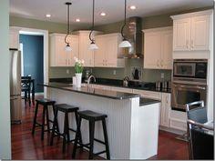 white cabinets, black countertop