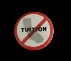 """The """"No Tuition"""" in California pin was found in the University's 25th Anniversary time capsule (1983). The pin depicts a map of California and the word """"Tuition"""" written over it, all overlaid with a red circle and line-through. CSUN University Archives."""