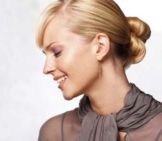 An elegant low, knotted bun works well with long hair of all one length.