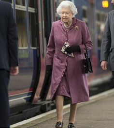 Queen Elizabeth II was seen at Kings Lynn station this morning looking refreshed in a tailored mauve coat, 10.02.2014