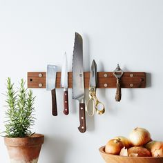 """I'm stickin' with you."" —Your knives magnetic knife holder that is beautiful - not too industrial looking."