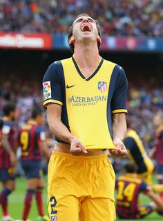 Diego Godin of Club Atletico de Madrid celebrates after scoring his goal during the La Liga match between FC Barcelona and Club Atletico de Madrid at Camp Nou on May 17, 2014 in Barcelona, Catalonia.
