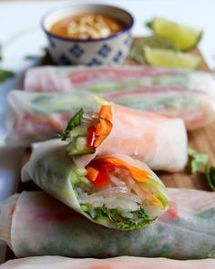 Looking for an easy and healthy, yet super satisfying Vietnamese spring rolls recipe? These vegan, gluten-free rolls are packed with fresh vegetables, flavorful herbs, noodles, and lots of beautiful, bright colors. And they're complete with a deliciously spicy peanut dipping sauce!
