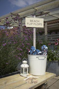 Beach flip flops. #coastalweddings