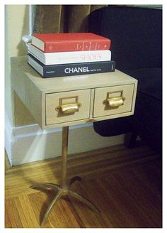 Repurpose a Card Catalog (I'd prefer to use a wooden 1) attach it to a leg stand.