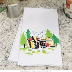 Log Cabin Tea Towel   Vintage Kitchen Towels   RetroPlanet.com Kick up the vintage vibe in your kitchen or dining room with this Log Cabin Kitchen Towel! Made of durable, printed cotton, the cozy country cottage adds delightful retro charm to any cooking or eating area. Perfect for parties and holiday events, this tea towel also makes a great hostess gift or gift for mom!
