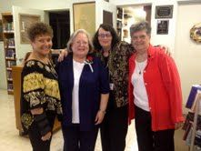 Friends Board Members and Library Trustees share a photo with Linda Tufaro at her Retirement Reception.  From left to right are Jo Scheel, Linda Tufaro, Kathleen Holland and Carol McIntosh