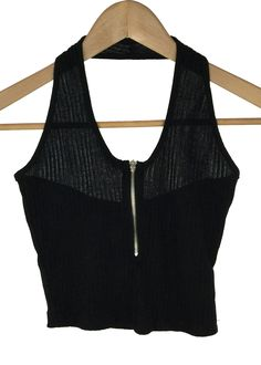 knit crop top with a halter strap V-neckline featuring a zipper 61% polyester,33% rayon and 6% spandex made in USA