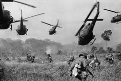 This photograph was taken by German photojournalist and two-time Pulitzer Prize winner Horst Faas. It shows hovering U.S. Army helicopters pour machine-gun fire into the tree line to cover the advance of South Vietnamese ground troops as they attack a Viet Cong camp eighteen miles north of Tay Ninh, near the Cambodian border, March 1965