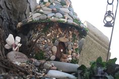 make a stone fairy house from a plastic bottle