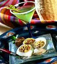 Sour Apple Margarita -  Ingredients:  3 ounces MR & MRS T® Margarita Mix   1 ounce sour apple liqueur   1-1/2 ounces tequila   1/2 ounce ROSE'S® Lime Juice   1/2 ounce ROSE'S® Triple Sec   1/2 cup ice   1 lime, sliced   50/50 cinnamon/sugar mixture (optional)