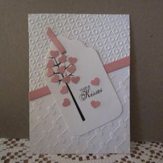 handmade card ... Hugs & Kisses by shendrian  ... pink and white ... tag focal point ... luv the use of two theme related embossing folder textures ...