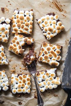 Rich tasting s'mores bars with a traditional buttery graham cracker crust, thick chocolate ganache center and toasted marshmallow top.