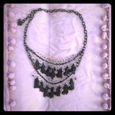 Silver/lucite beaded necklace Brushed silver (more grey or gunmetal in color than silver) with clear beads. Necklace is quite a statement piece! Will dress up any T-shirt!!  ❤️ 2 layers with adjustable hook closure. Can be worn long or short. Gotta love it! Summer fashion fun! ☀️ Jewelry Necklaces
