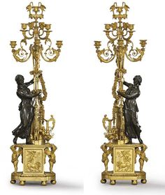CIRCA 1790, POSSIBLY AFTER A DESIGN BY JEAN-DEMOSTHENE DUGOURC AND ATTRIBUTED TO PIERRE-PHILIPPE THOMIRE<br>Each with a classically draped maiden modelled standing beside a tripod torchère supporting two-tiers of scrolling branches, cast with trumpets and butterflies and centred by a vase-shaped nozzle flanked by storks on a lambrequined platform, draped with fruiting garlands and flanked by a ewer with a winged putto, on a rectangular rounded breakfront plinth with gadrooned rim, supported…