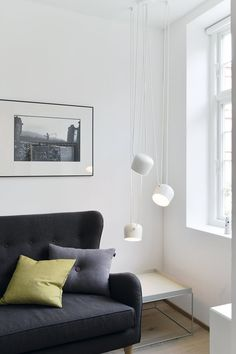 The grey sofa is a subtle contrast to the rest of the bright room. The pendants are from Flos and looks like a piece of art hanging in the corner of the bedroom. Interior Rugs, Arch Interior, Boutique Interior Design, Bright Rooms, Gray Sofa, Cozy Corner, Living Room Lighting, Hanging Art, Home Goods