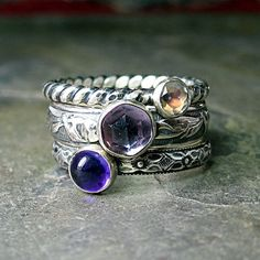 French Lavender - a sweet set of 3 stacking rings I made before the Christmas rush, but just now getting them in the shop!  Beautiful light amethyst in the center, paired with a deep purple amethyst, and a super rainbow moonstone that lives up to its name!    ...from LavenderCottage on Etsy