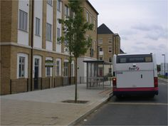 A wide smooth pavement, tree planting within the pavement with plenty of space to go around and a covered bus shelter. Image courtesy of Sandra Manley, UWE. Tree Planting, Trees To Plant, Bus Shelters, Go Around, Pavement, Smooth, To Go, Space, Plants