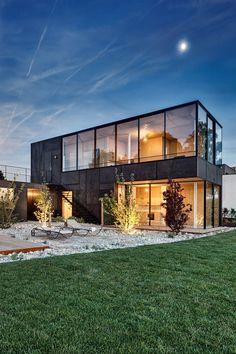 Ferien am See - in einem wahnsinnig modernen Haus mit toller Glas-Fassade und schönem Garten!