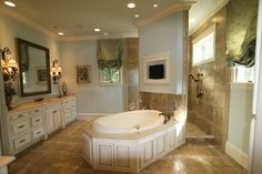 Large tub in the center of the room with a walk-through oversized shower behind the tub on the other side of the wall. by wendyrhea67