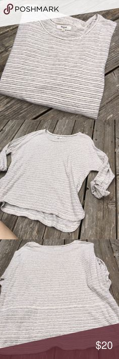 Madewell 3/4 Sleeve Top Comfy, classic, and basic top from Madewell! The fabric has a really cool texture to it, and the top of the shoulder had really nice stitching that gives this top a nice finish. Has a slightly longer hem in back with a cute split hem. EUC! Madewell Tops Tees - Short Sleeve