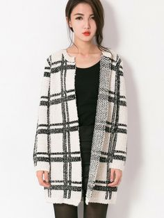 Stand-out Open front Cardigan $35.00  This Stand-out Open front Cardigan features a  regular fit cardigan made up of acrylic and wool fabric. Open front. White, checkered in black. Round neck. Long sleeves and is open for alteration to shorten.