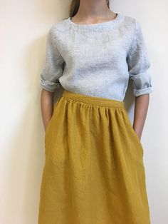 Long yellow linen skirt for women with drawstring waist. This mustard yellow midi skirt is made from 100% Lithuanian linen. Linen is one of the seasons hottest fabrics for adding rich texture to your outfit. Made in our small home studio, this midi style has soft fluted pleats to create gentle