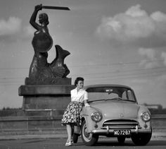 Syrena (Mermaid) car parked by the Syrenka Warszawska (the Mermaid of Warsaw) monument, 1962 Vintage Cars, Vintage Photos, Poland People, Fiat 126, Nostalgia, Visit Poland, Car Polish, Good Old Times, Horse Carriage