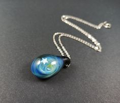 Silver fumed glass galaxy pendant with a floating opal star, handblown blue glass galaxy pendant, drop shaped galaxy necklace with star opal Unique Necklaces, Glass Pendants, Necklace Lengths, Opal, Pendant Necklace, Orange Pink, Silver, Stainless Steel