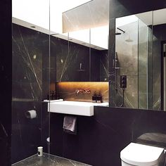 This is my bathroom, we chose a dark gris marquina marble for a rich cave-like finish so the walls envelop whilst the skylight overhead lifts your attention to daylight and height. Like showering under a waterfall.  #luxuryinteriors #modernhome #interiordesigner #interiordesign #design #marblebathroom #rooflightovershower #mirrorbathroom #darkbathroom #darkmarble #greymarble
