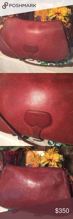 Prada Bag Authentic Vintage Prada- Large bag Sz 15x5x10- Genuine Leather- Deep burgundy wine color-Strap is badly worn needs immediate repair- Minor ink marks inside- Leather interior- Can be worn as a Crossbody- Very nice bag! I have additional pics listings on a separate listing- Please view all pic- Please feel free to ask questions. Prada Bags Shoulder Bags