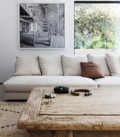 cushions, rug, textured coffee table