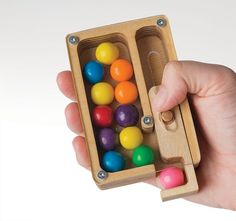 This little gumball machine can be stuck in a pocket for treats on the go. Designed by Levi Dojczman.