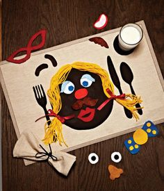 DIY Activity Placemat. Great way to keep kids entertained at the dinner table while they wait for their meal.