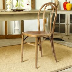 Complete your dining room with these vintage inspired chairs constructed of durable elm wood. Featuring an elegant tan finish, these pieces are a stylish addition to any space.