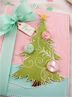pink,teal, green tree card...buy pre-cut tree...add buttons..ribbon..sew around edges..take out thread...perfect spaced holes