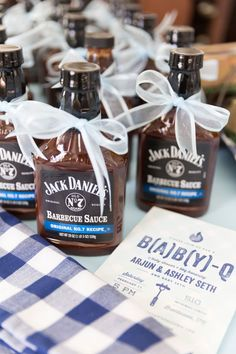 """This B(A)B(Y)-Q Shower Theme Is So Cute, We Could Just Eat It Up:  """"My favorite part of the shower was certainly styling all the little details,"""" Whitmore says. """"I loved the cute favor idea to give out barbecue sauce to guests as they left the party! We decided on Jack Daniels since it's a Tennessee brand! Ashley and her husband absolutely adored all the sweet details including the garland of baby pictures of both her and her husband."""""""
