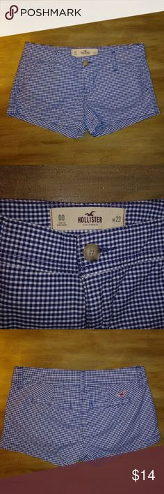 """Junior's Blue & White Plaid HOLLISTER shorts Up for sale is a pair of Junior's Blue & White Plaid shorts from HOLLISTER ~~ Size 00  These shorts are a plaid checkered design in blue & white! Super cute!!  Inseam: 2"""" and Total Length: 8""""  These (boots) come from my clean smoke free and pet free home. No flaws or stains! If you have any questions, please feel free to contact me. Hollister Shorts"""