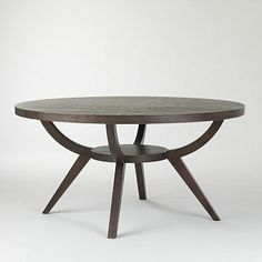 """Arc Base Pedestal Table #westelm  Gather 'round. Set on a sculptural solid wood base inspired by 1930s Art Deco lines, our smoke-finish 60"""" Arc Base Pedestal Table seats up to six people in a conversation-conducive circle, while the 42"""" version can host a more intimate crowd of up to four.  42"""" table comfortably seats up to 4; 60"""" up to 6. Solid-wood base. Engineered wood top with smoke-stained ash veneer. 60"""" assembled upon arrival via In-Home Delivery.  Wipe clean. Imported."""