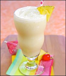 Hungry Girl recipe swap for guilt-free Piña Colada smoothie. Pin and blend away!