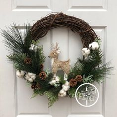 Dress your door with this eye catching woodland wreath. This wreath features various pine, cedar, natural pine cones, cotton bolls and a natural grass and faux fur deer in shades of green, tan and white. Tip to tip measurement is 22W 21L 5D Created on a 18 inch grapevine wreath