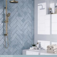 Enigma Polished Ceramic Ash Blue Tile is for residential and commercial walls. textured subway style adds depth and dimension. Blue Shower Tile, Shower Remodel, Bathroom Interior Design, Brass Shower Head, Bathroom Remodel Master, Bathroom Makeover, Blue Bathroom, Modern Bathroom, Bathroom