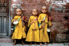3 young monks. They're babies! Why are they being made into monks? What about their childhood!