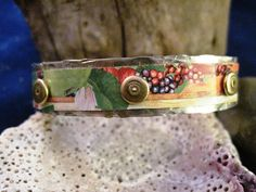 Multicolored tin and silver cuff bracelet by JanEOjewelry on Etsy, $19.95