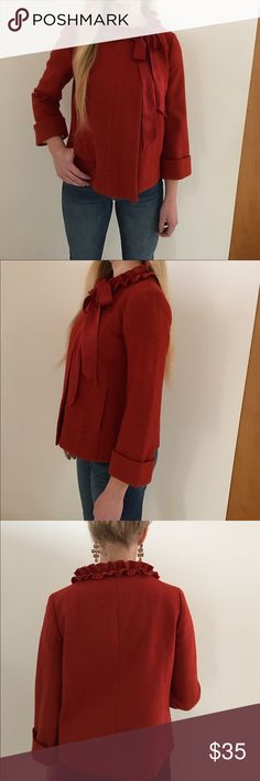 Autumn toned jacket with cuff and ribbon. Orange, cuffed size 2 blazer. Ruffled collar with two buttons that snap at neck and ribbon. Dry clean only. J. Crew Jackets & Coats Blazers
