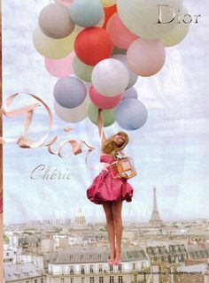 A girl with Balloons and Ribbons holding a Dior - Cherie parfum....it's  so charming to shop the Avenue Montaigne on a bike.