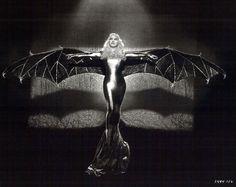 Mae West in fancy dress as a bat