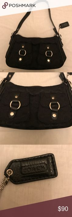 Barely used Black Coach Purse with Leather Handle! Gently used black Coach Purse with material with Coach C's all over. Has 2 cute pockets in front that snap and one zipper pocket on back. Inside is tan with zipper pocket and two pockets. Very clean and very newer! If you have any questions please feel free to contact me and thanks for looking!! Coach Bags Totes
