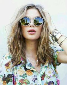 Bold floral shirt and sunglasses